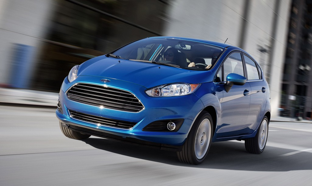 The Ford Fiesta gets new styling as part of a major update for 2014. Its nose looks more like the Fusion now, which in turn borrowed design elements from Aston Martin.