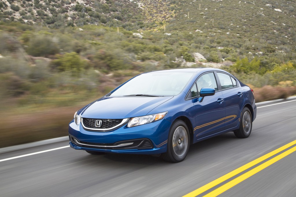 The Honda Civic, long known as a reliable car, gets an upgraded cabin and new features for 2014, including a side-view video camera.