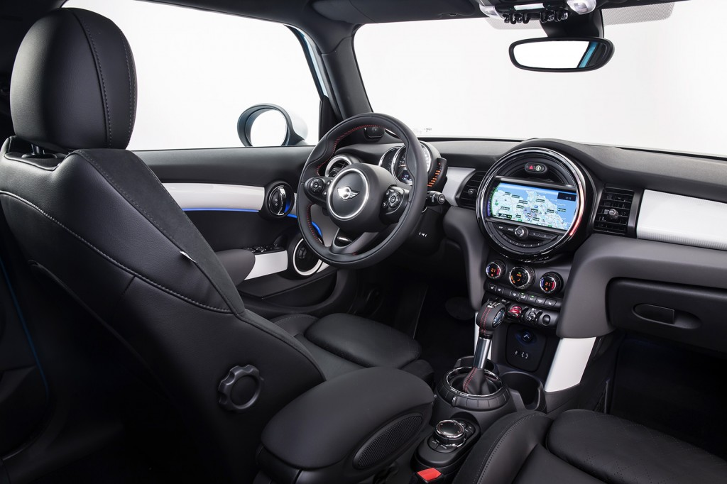 A giant, color-changing circle dominates the dash of the new four-door Cooper. It's fun and funky, keeping with the spirit of this car.