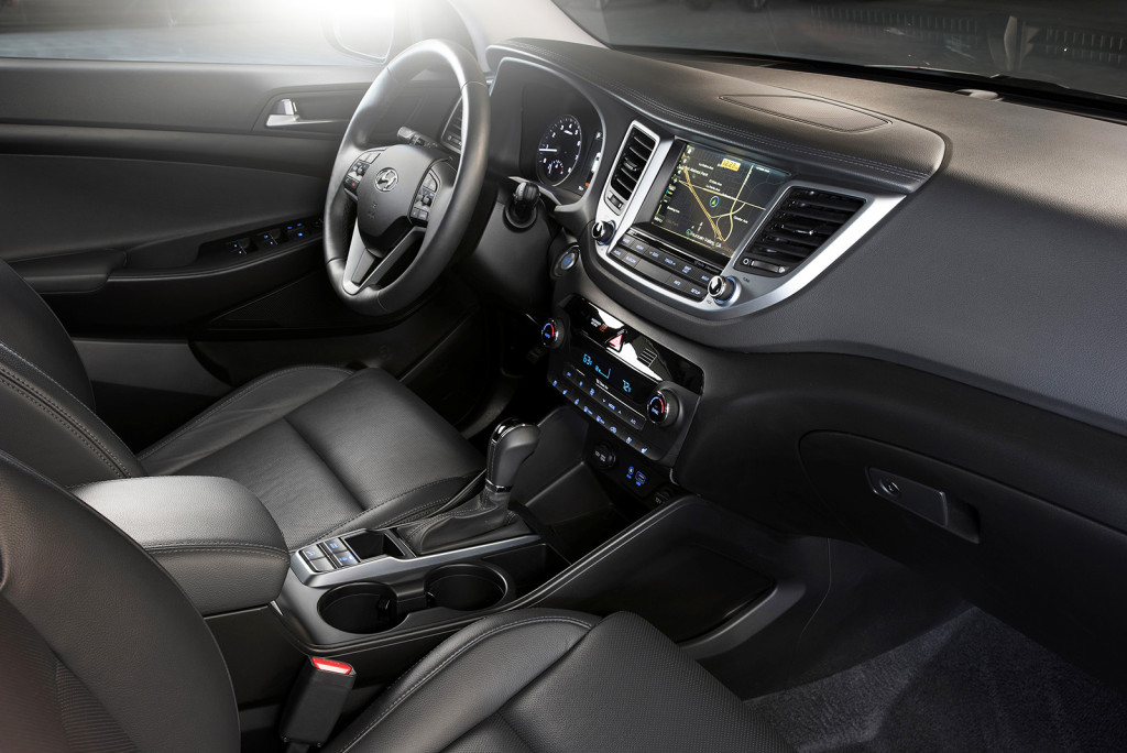A digital touchscreen mounted high on the dash, a prominent shifter and easy-to-access controls make the Tucson's cabin feel modern, athletic and simple to use.