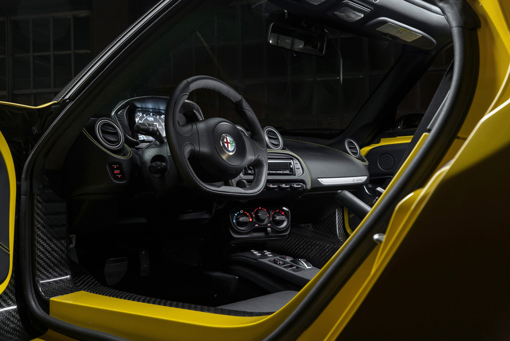 Parts of the carbon fiber chassis are exposed in the cabin of the 4C, showing the bones of its exotic, lightweight construction.