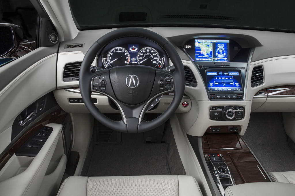 The RLX's cabin is heavy on technology, including two large digital screens on the center stack and a smaller display behind the steering wheel.