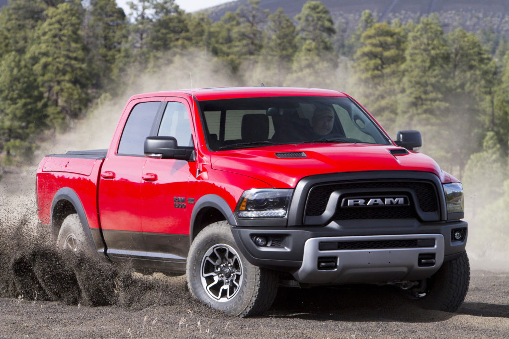"""The Ram 1500 Rebel shows its aggressive side with a blacked-out grille with silver """"RAM."""""""
