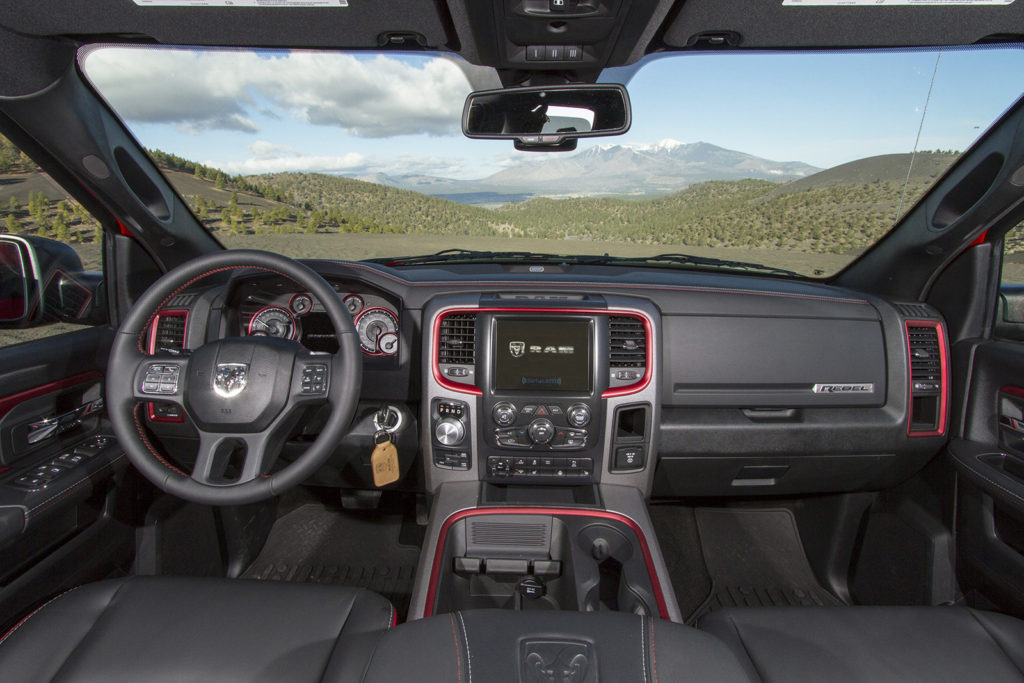 Eye-catching Radar Red trim gives the Rebel a show-truck look inside, with cloth and vinyl seats designed to be as durable as they are stylish.