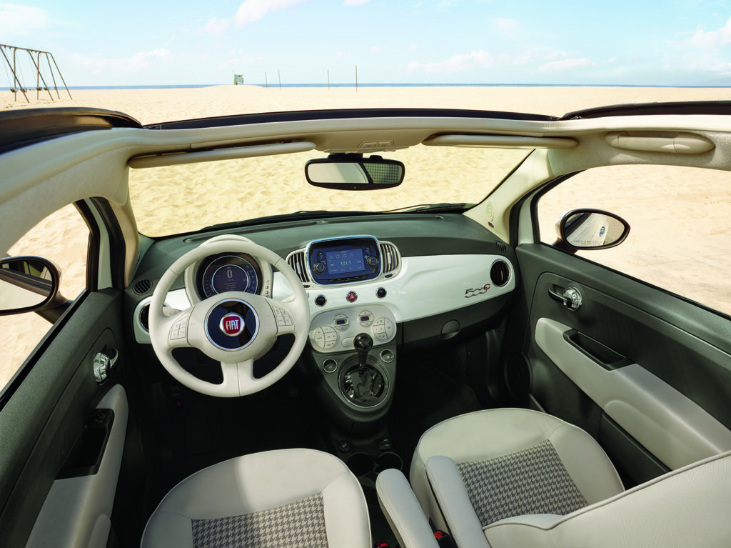 The 500 line has a classically styled interior. It also is available with an open-air version with a top that slides to the rear, almost like a convertible, called the 500C.