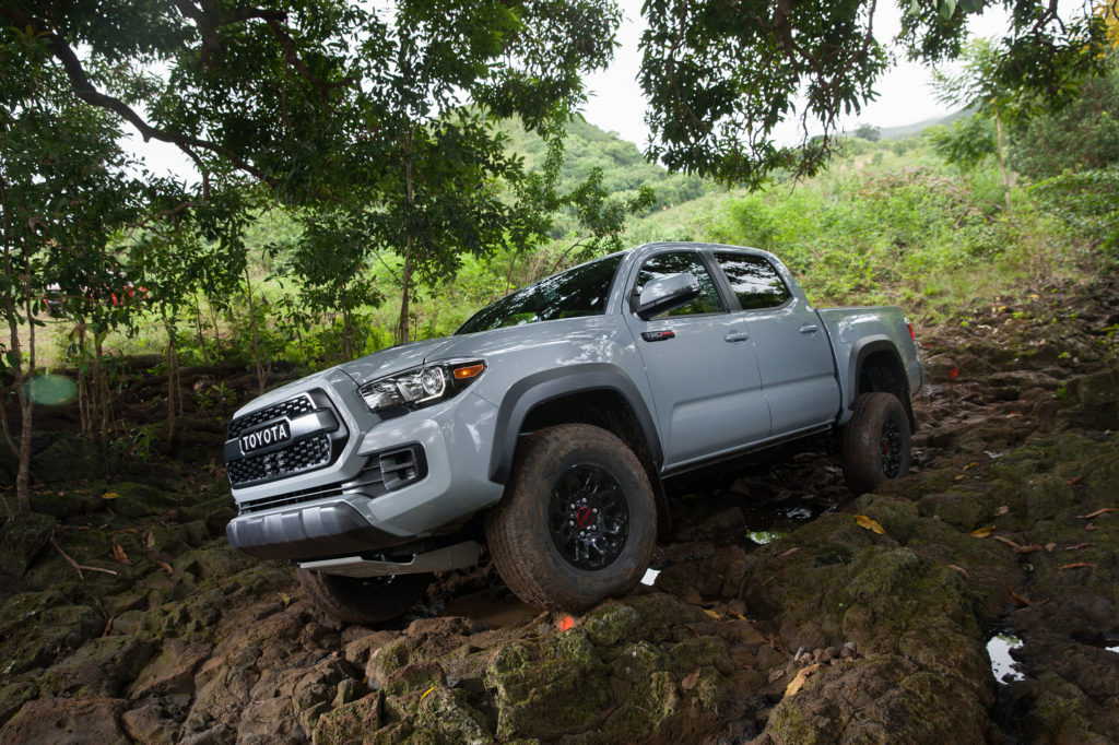 """A blacked-out hood scoop and heritage-inspired """"TOYOTA"""" front grille are part of the Tacoma TRD Pro's aggressive look."""